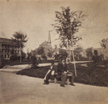 Boy and Man Sitting on Bench in Reservoir Square - New York, NY, USA, 1850 - 1899
